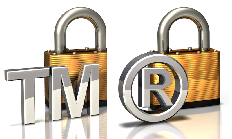 "Gold and silver padlock with ""TM"" trademark common-law symbol followed by thicker padlock with ""circled R"" registered trademark symbol"